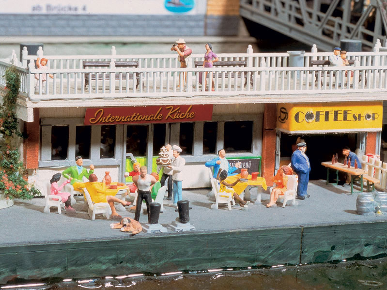 Miniature people visiting a miniature cafe near a miniature River Elbe in a miniature Hamburg Germany. Awe, it's so CUTE!