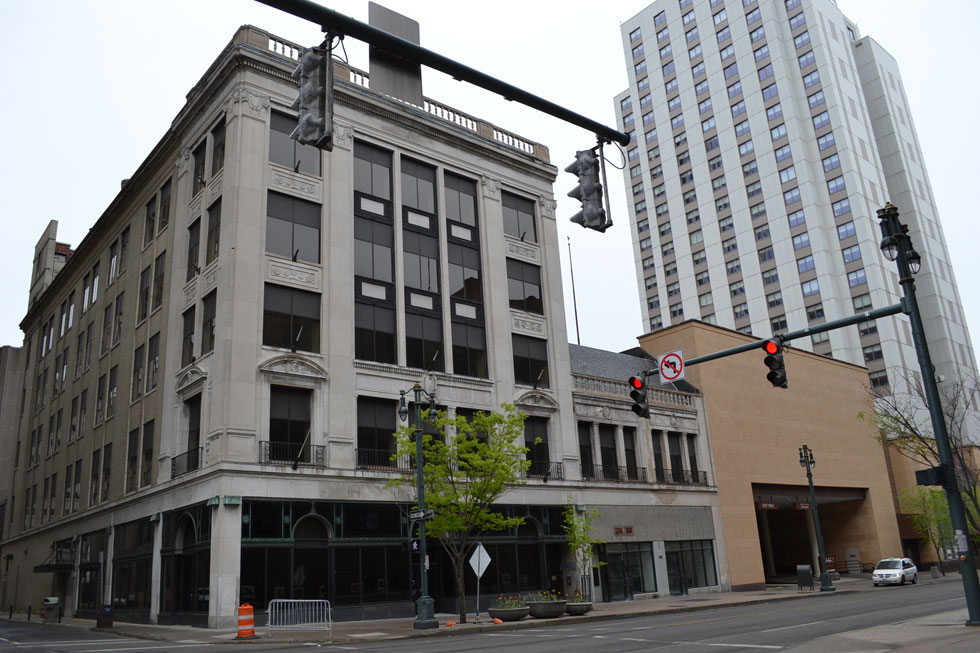 The Hilton hotel chain is strongly considering adapting this five-story former National Clothing Store on Main Street into a Hilton Garden Inn. [PHOTO: Rochester Public Library]