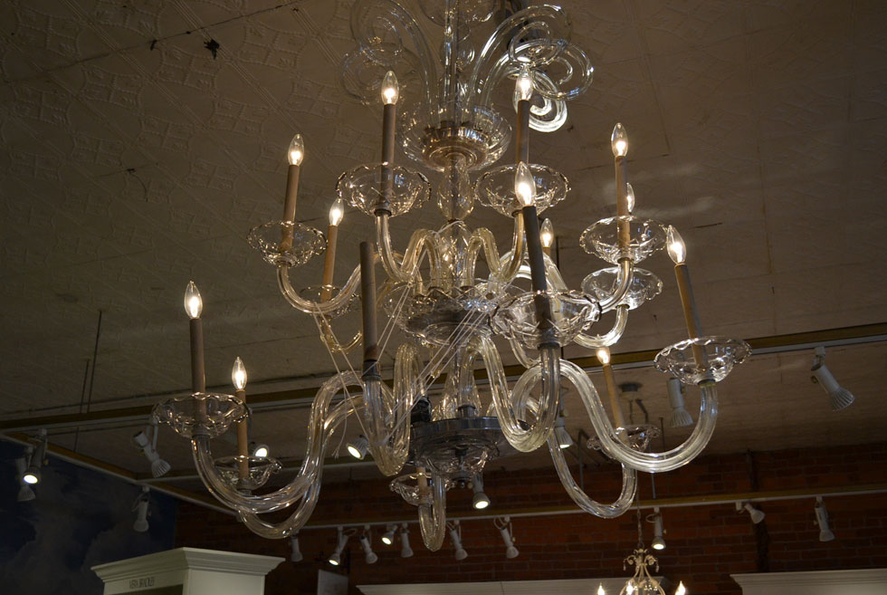 The chandelier is in fairly good condition except for one broken arm, now being held together with string. [PHOTO: RochesterSubway.com]
