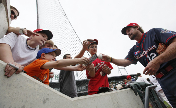 Former Boston Red Sox third baseman Wade Boggs signs autographs before the start of the exhibition game, which was sponsored by Pepsi Max. [PHOTO: Chris Russell, Columbus Dispatch]