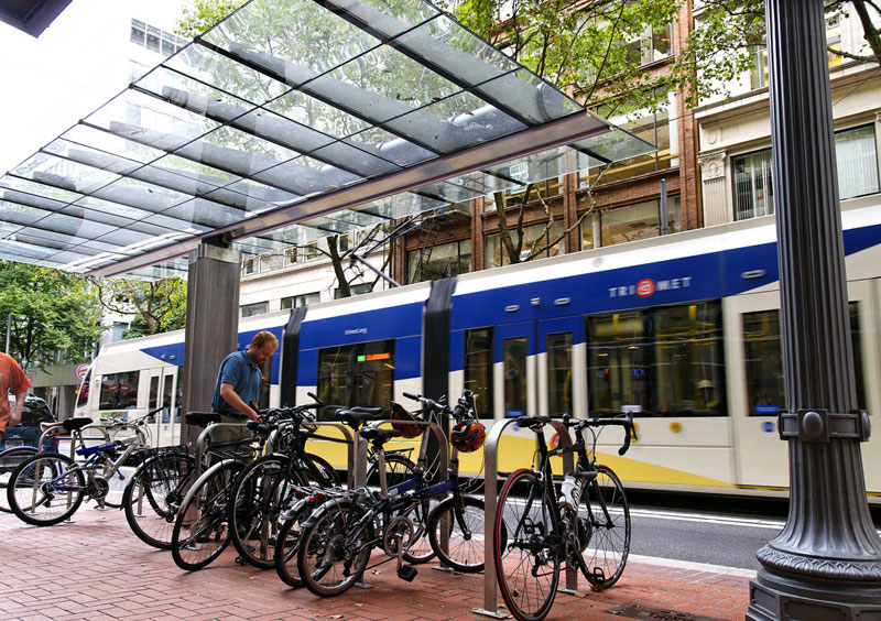Bus routes and streetcar lines converge on Portland's transit mall. Bikes, autos, buses, and streetcar share these streets and the area is referred to as Portland's living room because of the constant activity.