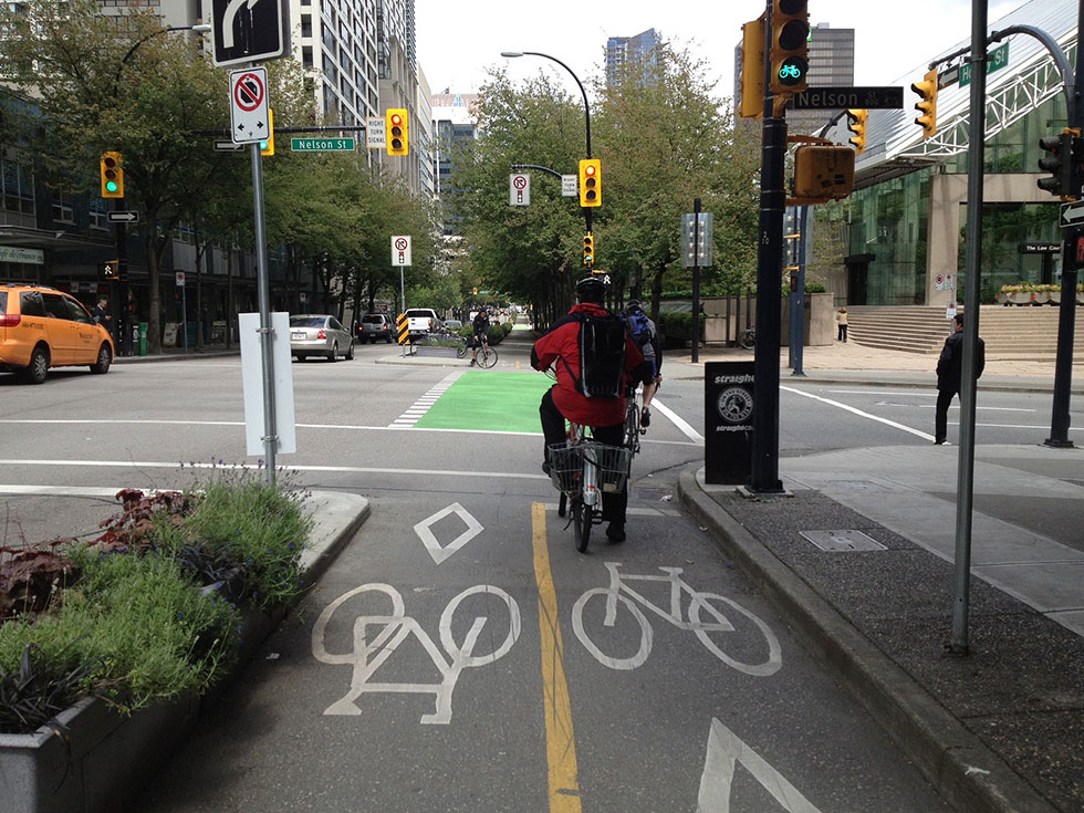 Harvey Botzman, a local cycling advocate, is calling for protected bike lanes for the full length of Main Street in Rochester. [PHOTO: San Francisco Bicycle Coalition, Flickr]
