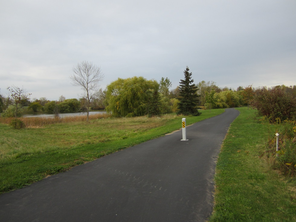 The path turns right, passes by a nice pond, then ends up on Island Cottage Road. [PHOTO: Ryan Green]