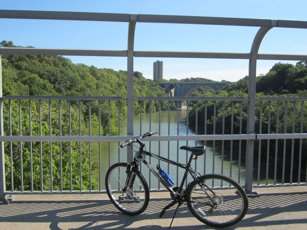 We can take a detour on a bike/pedestrian bridge, which links to the east riverbank, the zoo and other paths. [PHOTO: Ryan Green]
