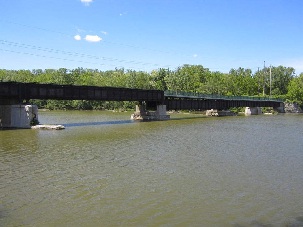 The relatively newly converted train bridge (Erie-Lackawanna Railroad Bridge) that links the U of R to the west bank Genesee Riverway Trail. [PHOTO: Ryan Green]