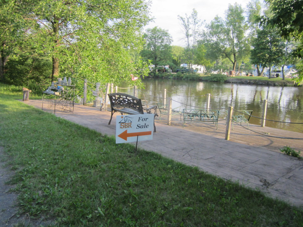 A yard sale and property advertised along the canal trail? I am often surprised as to what I find on this path. [PHOTO: Ryan Green]