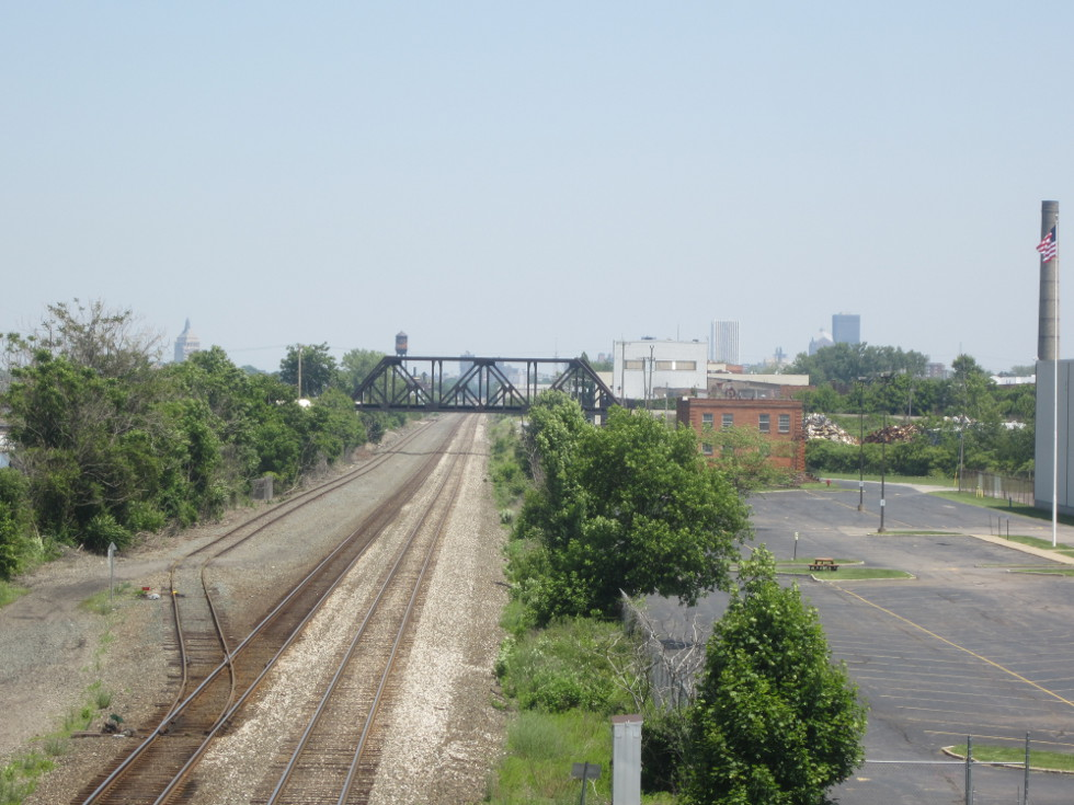 Looking East, we can see the city in the distance. We are high over the tracks, and even higher over the canal.  [PHOTO: Ryan Green]