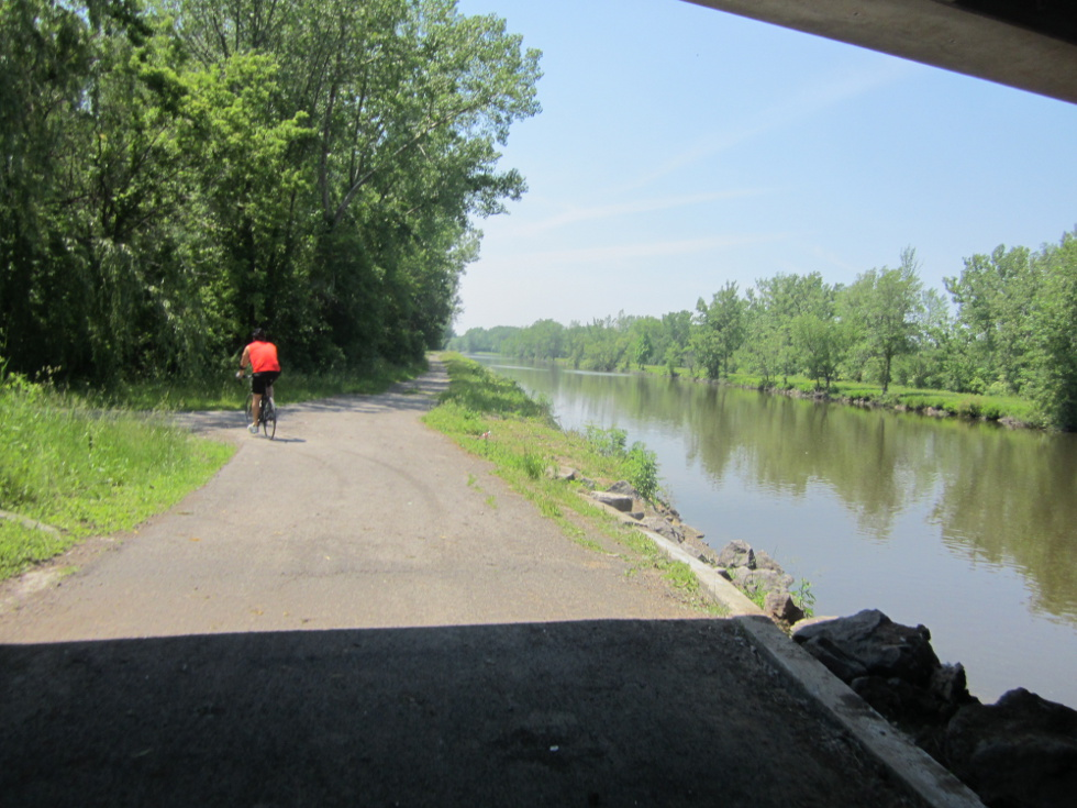 This guy had the right idea: Right after the little rest area, at 9 miles on this route, head under Long Pond Road, and take a left to get on the road to cross the canal and connect with the trail on the other side. [PHOTO: Ryan Green]