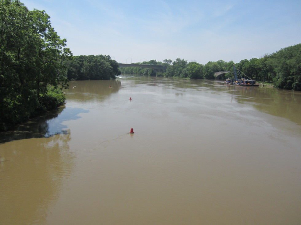 The boats and barge crane visible here are used to maintain the canal a proper depth as it crosses the muddy Genesee River. [PHOTO: Ryan Green]