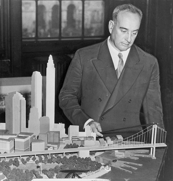 Robert Moses, American urban planner, with a model of his proposed Battery Bridge.