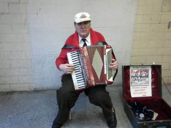 Walter, Rochester's accordion man, playing outside an Amerks hockey game in the War Memorial parking garage tunnel. [PHOTO: Craigslist]