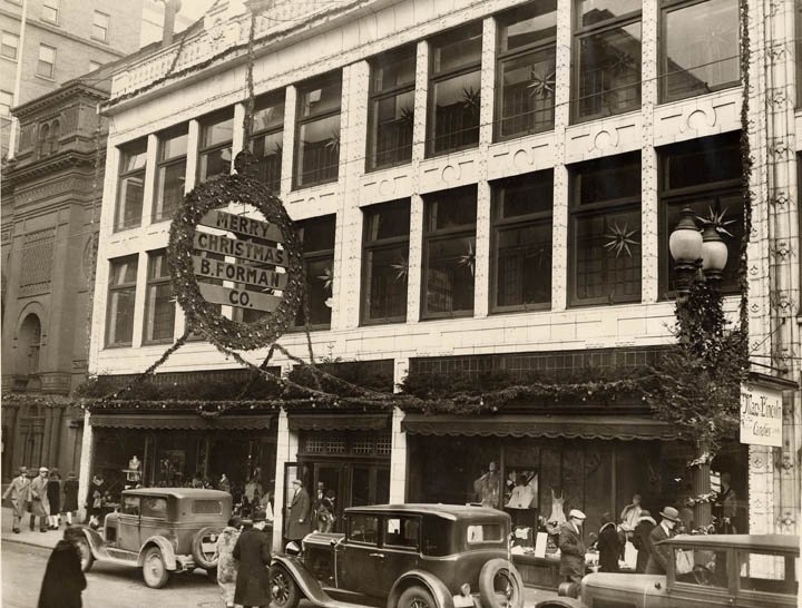 A view of the the fac̨ade of the B. Forman Co. store at 46-50 Clinton Avenue South. Christmas decorations are visible. c.1930. [PHOTO: Rochester Public Library]