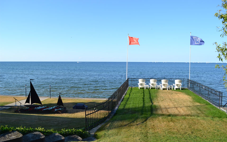 Adirondack chairs on their own little grassy pier. This is someone's backyard. Nice view.