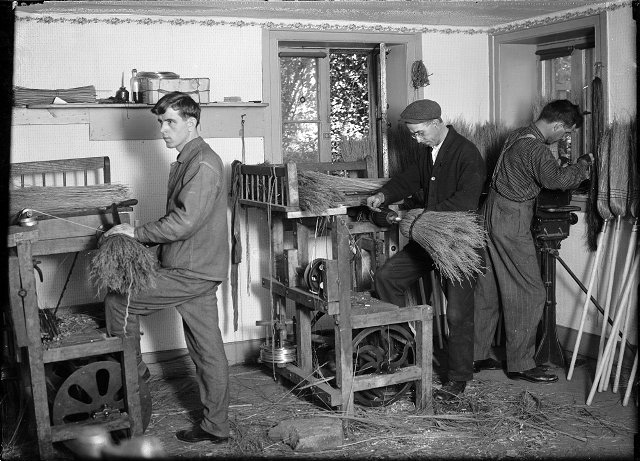 Blind broom makers at the Rochester Association for the Blind on Main Street at Gibbs Street. c.1916. [PHOTO: Albert R. Stone Collection]
