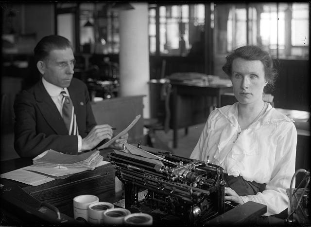 A blind young woman works at a typewriter in a factory on Saint Paul Street. c.1920. [PHOTO: Albert R. Stone Collection]