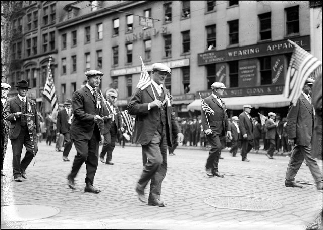 Brewery Union members holding American flags march down Main Street East in the 1919 Rochester Labor Day Parade. [PHOTO: Albert R. Stone Collection]