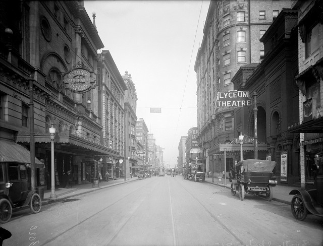 The Seneca Hotel (right) on Clinton Avenue with the Temple and Lyceum Theatres in the foreground. [PHOTO: Albert R. Stone Collection]