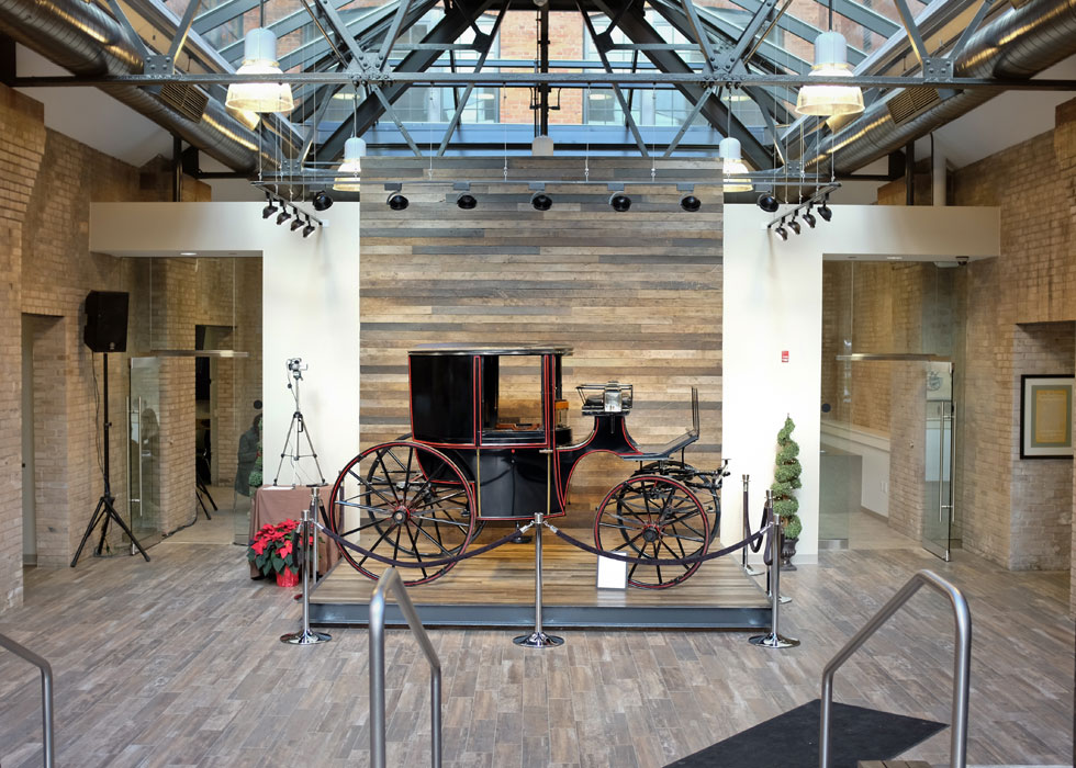 An original Cunningham carriage is now on display here in the atrium. [PHOTO PROVIDED BY: Preservation Studios]