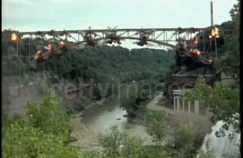A still frame from video of the Driving Park Bridge demolition. [VIDEO STILL: Getty Images]