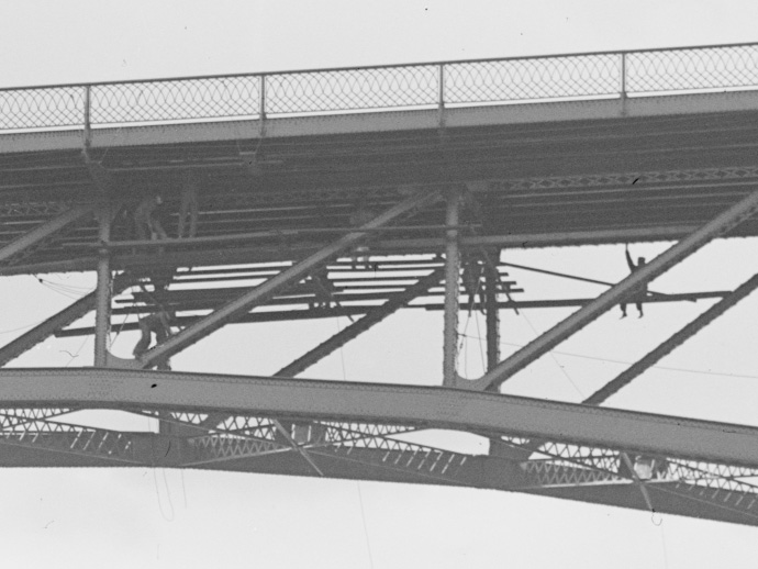 Several workers beneath the road deck of the Driving Park Bridge, Rochester, NY.