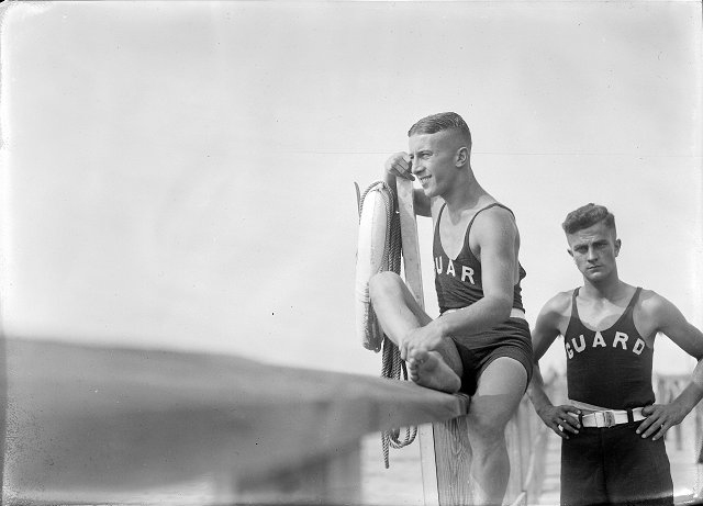 Lifeguards Roy Ackerman and Bud Martin are shown on duty at the beach at Durand-Eastman Park. August, 1921. [PHOTO: Albert R. Stone]