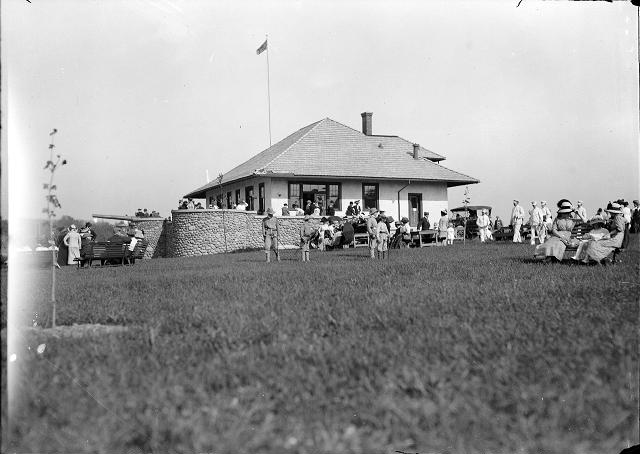 People gather at the new refectory at Durand-Eastman Park on its opening day in 1912. Members of the band approach at the right. [PHOTO: Albert R. Stone]