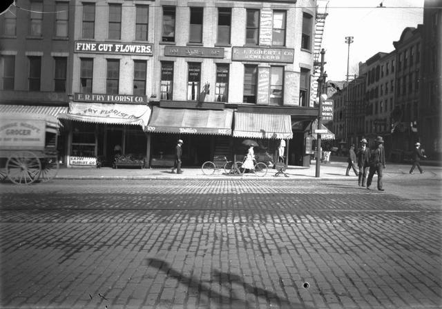 Shops on Rochester's Main Street at Water Street. August 23, 1900. [PHOTO: Rochester Municipal Archives]