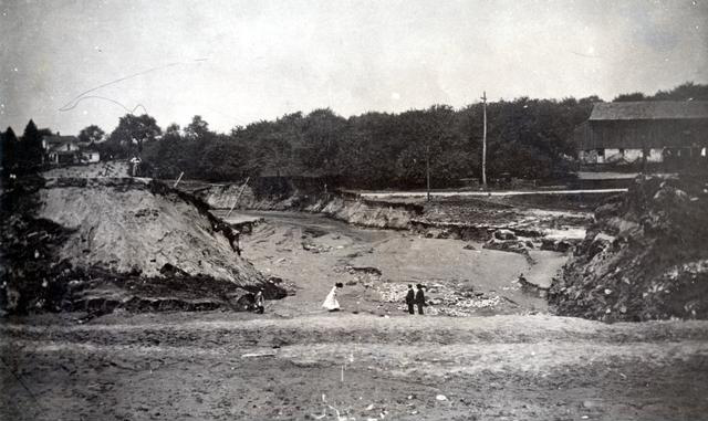 Looking north through the gap in the north wall of newly completed Barge Canal. A break occurred at Bushnell's Basin on May 19, 1911. [PHOTO: Perinton Municipal Historian collection]