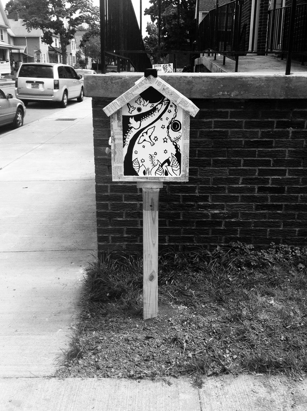 A Little Free Library at 125 Caroline Street. Rochester, NY. [PHOTO: Deanna Varble]