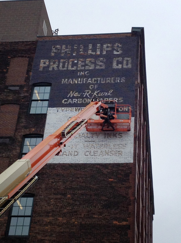 The High Falls Business Association has been repainting some of the old 'ghost' advertising signs on buildings along Mill Street. [PHOTO: RochesterSubway.com]