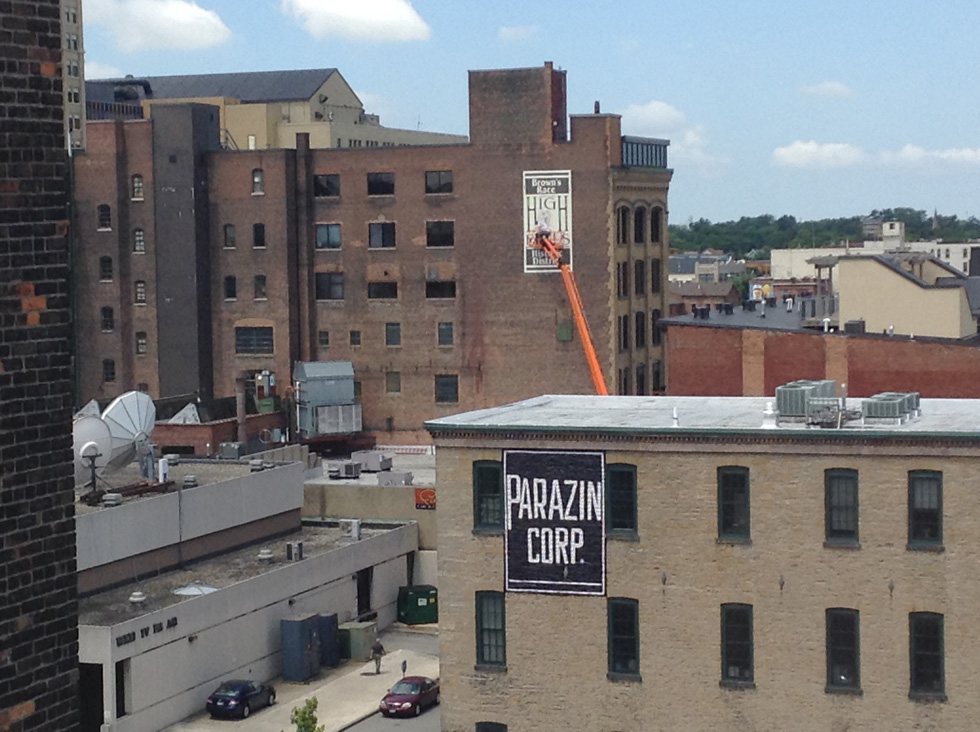 The High Falls Business Association has been repainting some of the old 'ghost' advertising signs on buildings along Mill Street. The High Falls waterwheel logo is a new addition. [PHOTO: RochesterSubway.com]