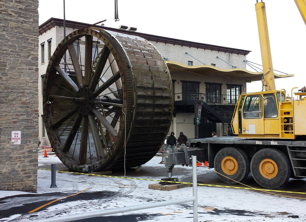 The triphammer water wheel in High Falls, Rochester NY being removed from its housing so it can be restored. [PHOTO: Tom Dubois]