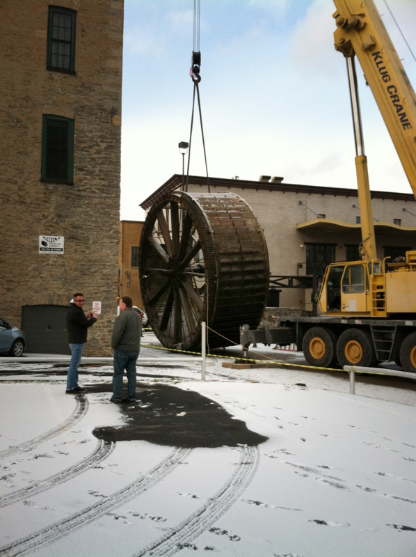 The triphammer water wheel in High Falls, Rochester NY being removed from its housing so it can be restored. [PHOTO: Peter Simpson]