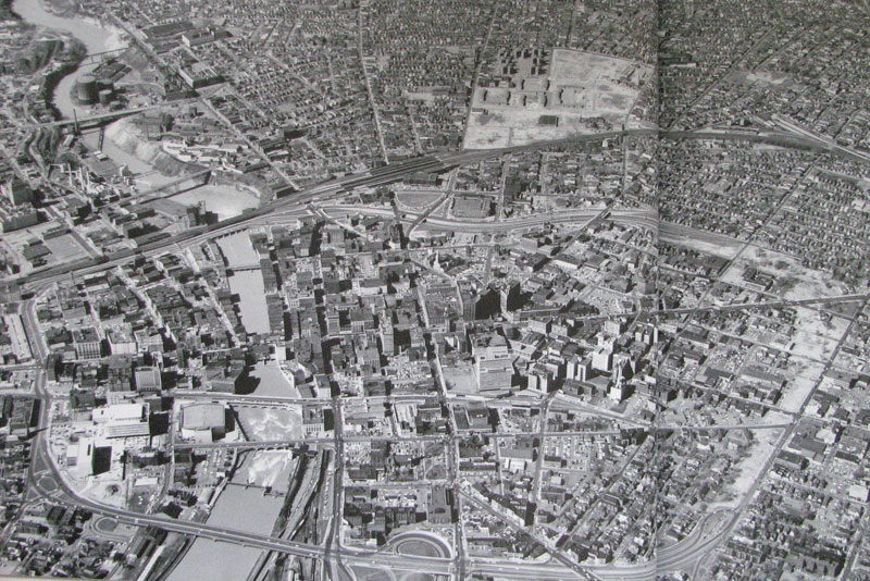 An aerial view of Rochester on April 25, 1963. On the right is the cleared right-of-way for the final segment of the Inner Loop. [PHOTO: Local History Division, Central Library of Rochester.]