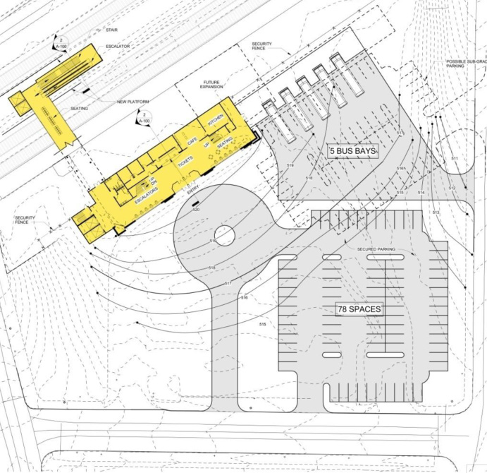 This plan option places the building up against the tracks with a parking lot situated between the building and the street.