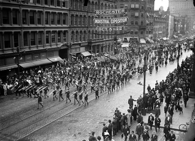 A banner advertises Rochester's annual Industrial Exposition during the 1910 Labor Day Parade. [PHOTO: Albert R. Stone Collection]