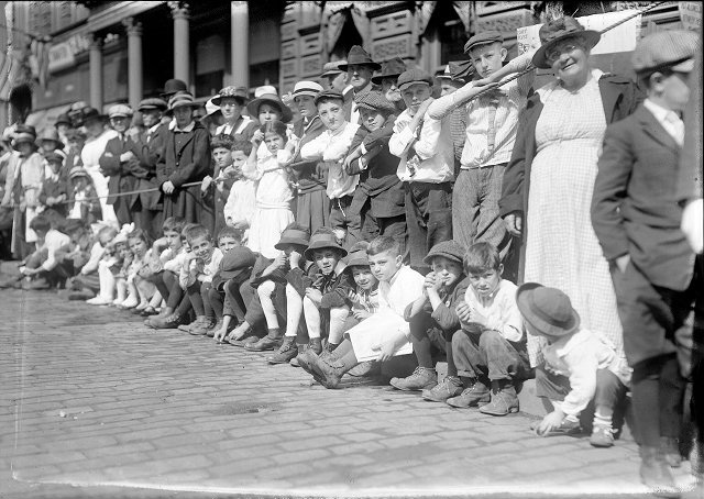 Crowds line Main Street near Four Corners to watch the 1917 Labor Day Parade. [PHOTO: Albert R. Stone Collection]