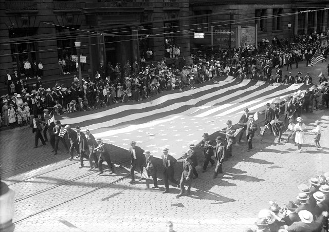 Members of the Silver Platers and Metal Polishers Union carry a large flag in Rochester's 1918 Labor Day Parade. [PHOTO: Albert R. Stone Collection]