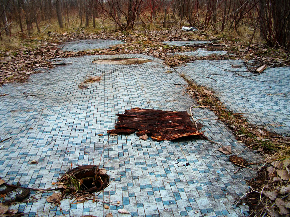 The last surviving remnant of the old theater is this tiled bathroom floor. [PHOTO: RochesterSubway.com]