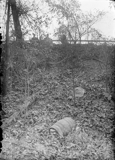 The barrel was covered with a piece of burlap which came off as the barrel rolled down the hill. [PHOTO: Albert R. Stone]