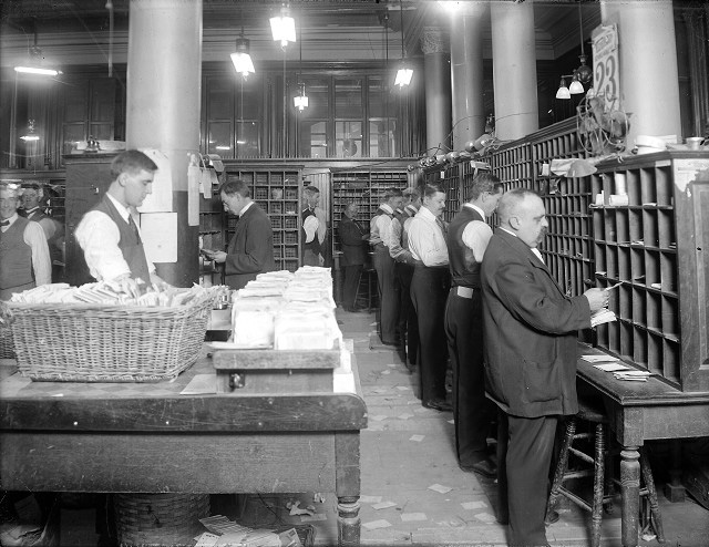 Mail sorters around holiday time. c.1910. [PHOTO: Albert R. Stone Collection]