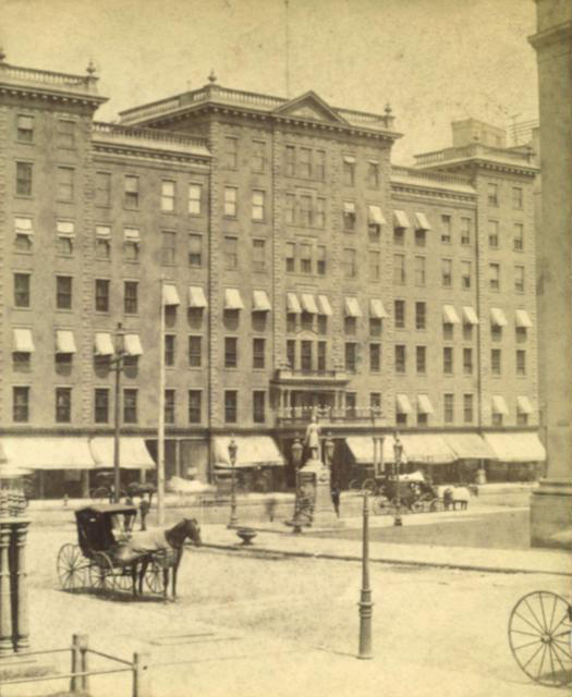A view of the Cogswell Fountain at the corner of Main and Fitzhugh, looking north with the Powers Hotel in the background. [PHOTO: Rochester Public Library]