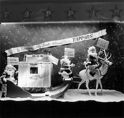 This scene shows Santa Claus in a sleigh carrying a Tappan range. 'Six reasons why Santa delivers more Tappans.' c.1940. [PHOTO: Rochester Public Library]