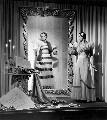'The Romantic 1889 Viennese Fashions of 'Mayerling'' This scene shows mannequins in evening gowns. c.1940. [PHOTO: Rochester Public Library]