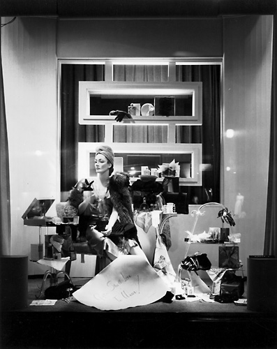 'Gifts she'll love to wear!' This scene features a mannequin in a fashionable dress posed alongside of various accessories. c.1940. [PHOTO: Rochester Public Library]
