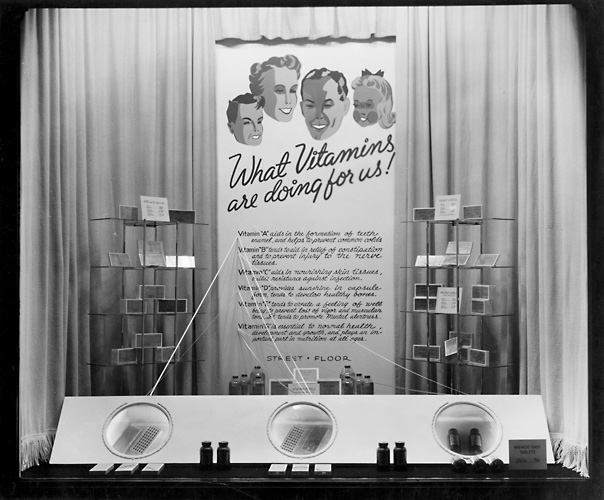 'What vitamins are doing for us!' A display of vitamins for sale. c.1940. [PHOTO: Rochester Public Library]