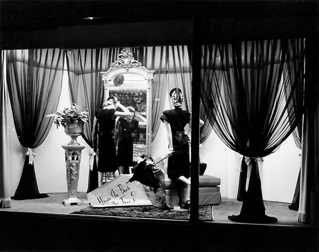 This scene shows mannequins in fashionable dress in front of a mirror. c.1940. [PHOTO: Rochester Public Library]