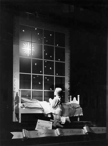 'Christmas, Keep it Shining for all the World.' This scene shows a child praying before a Christmas star. c.1940. [PHOTO: Rochester Public Library]