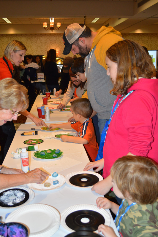 Painting records to look like Christmas wreaths was a fun activity. My brother and I each painted one of these. [PHOTO: Ella's Mom]