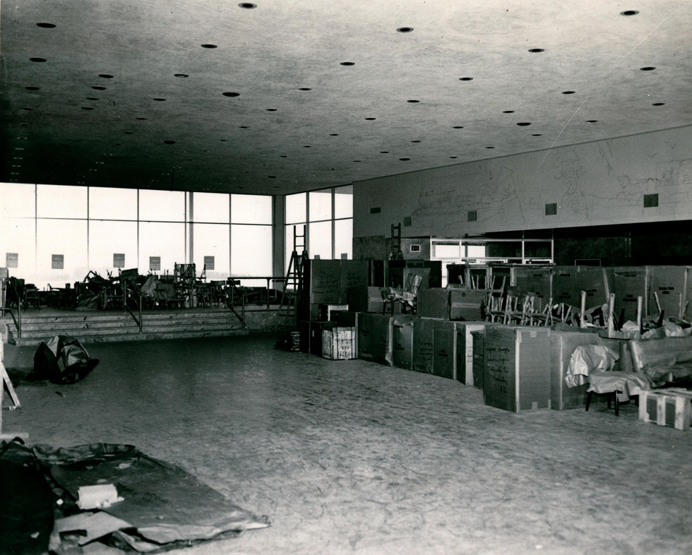 Inside the terminal, an outline of the mural can be seen on the wall above the doors. [IMAGE: Rochester Public Library Local History Division]